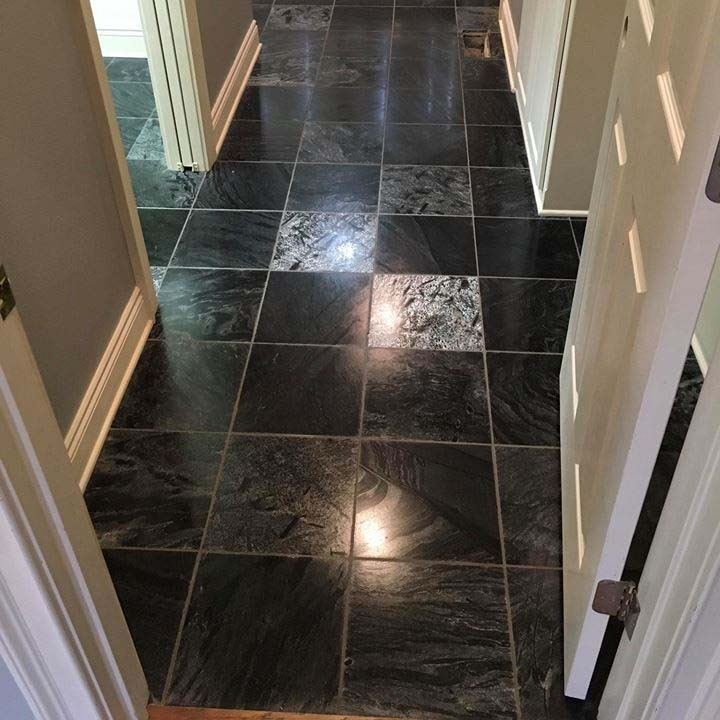 shiny tile and grout black floor